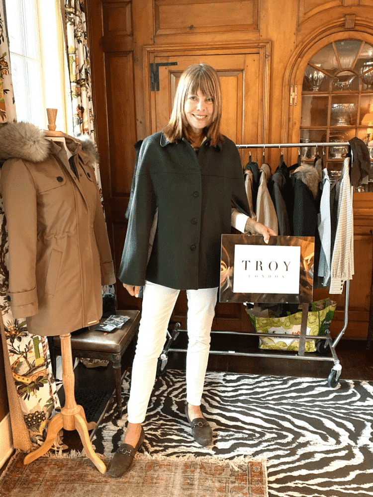 Pam Taylor wear a cape by Rosie van Cutsem Troy London Brand.